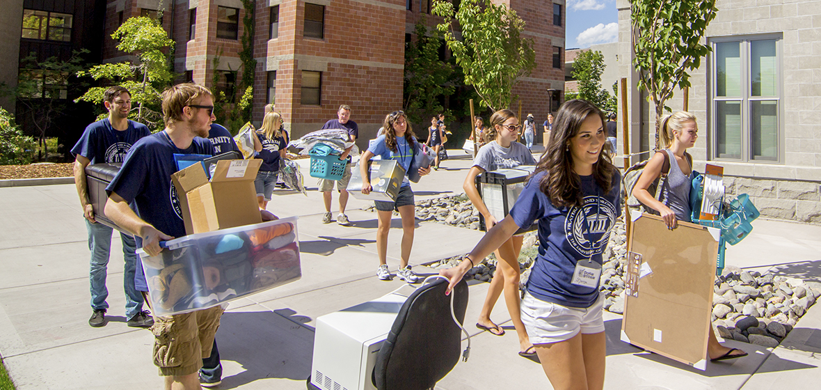 Students move stuff into dorms.