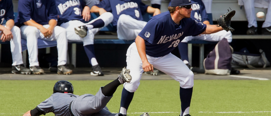 UNR baseball player catching ball.
