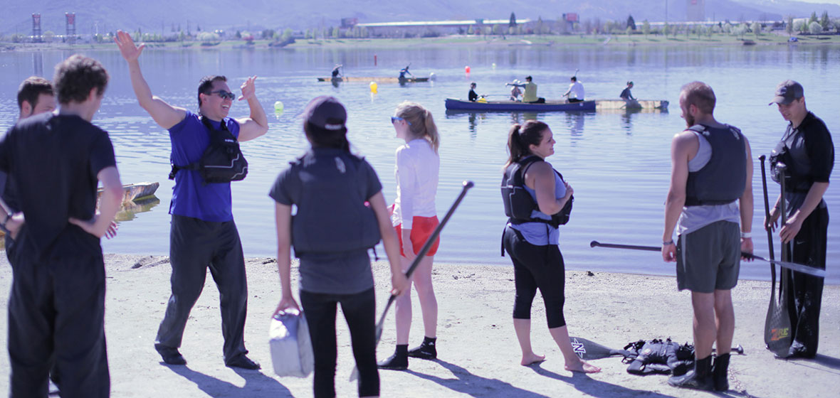 Students hang out at lake during practice for canoe event