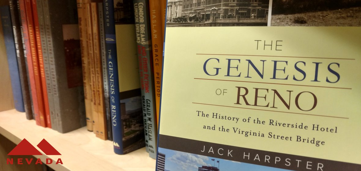 The Genesis of Reno book with other University of Nevada Press books on the shelf