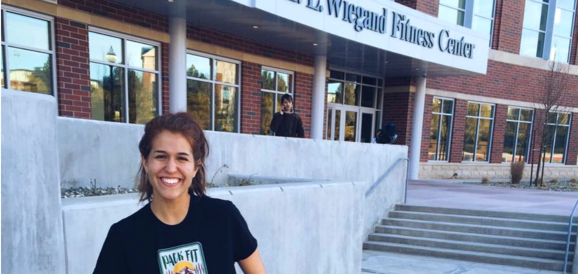 Claire Santamaria in front of the E.L. Wiegand Fitness Center