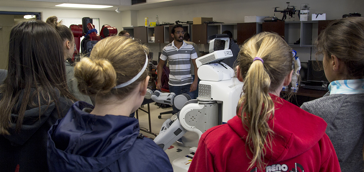 Students are shown how robots work by assistant researcher at the University of Nevada.
