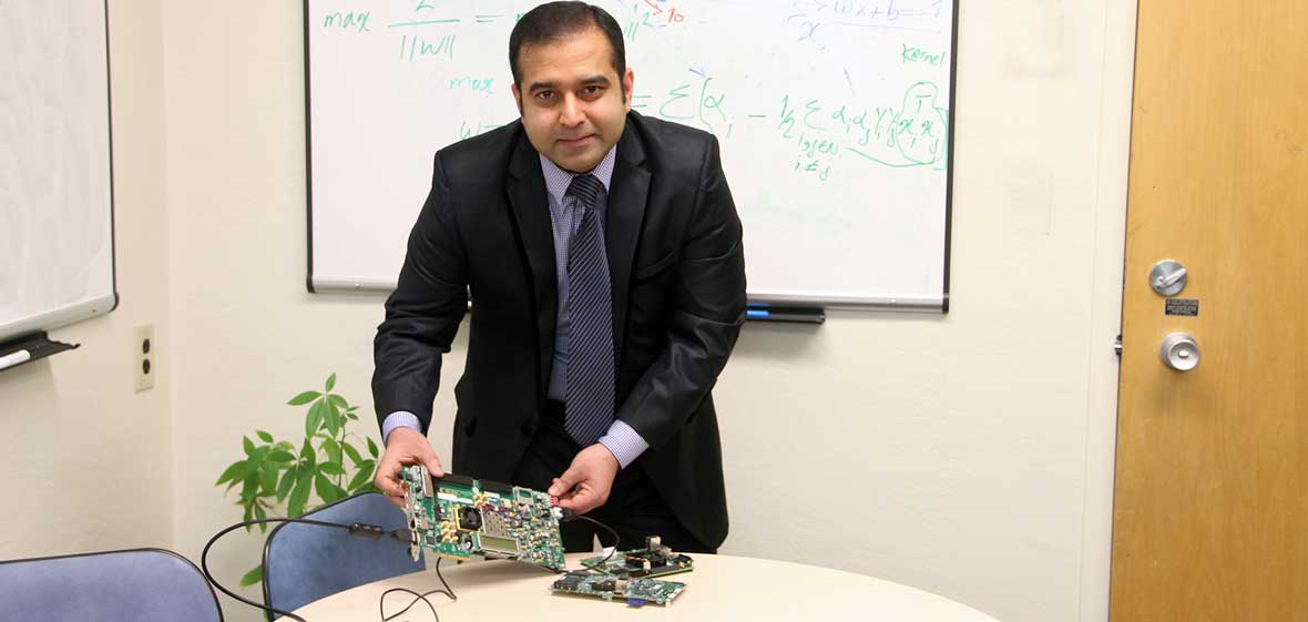 Arslan Munir with a prototyping board