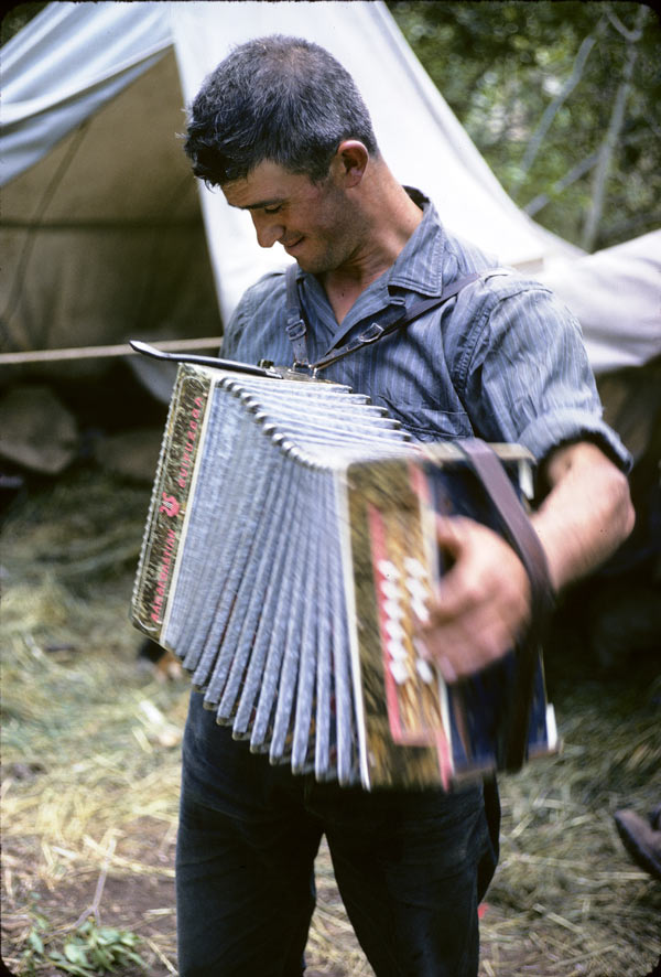 A Basque sheepherder plays the Trikitixa – a Basque accordion – to entertain himself at camp