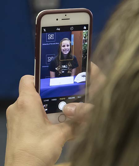A cell phone photo being taken during a Nevada Scholars Signing Day ceremony