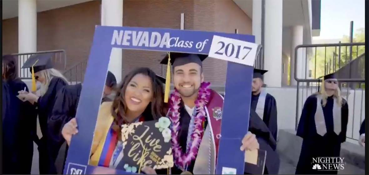 Two University graduates hold Nevada Class of 2017 photo frame