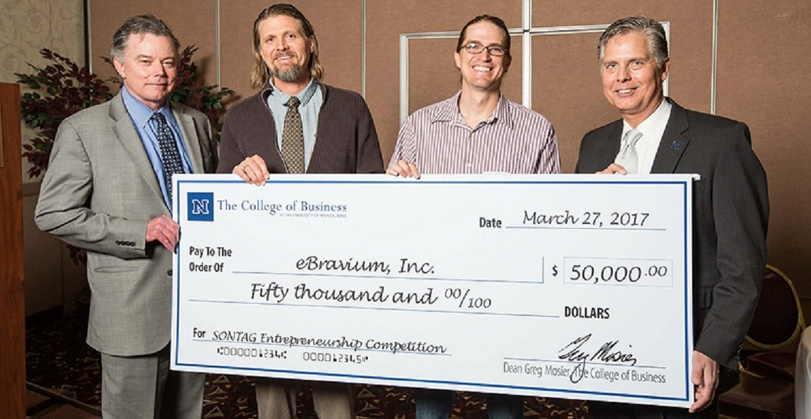 Executive Vice President and Provost Kevin Carman, Patrick Grimes, Cody Grimes and College of Business Dean Greg Mosier pose behind a Sontag Entrepreneurship Competition check to eBravium for $50000.
