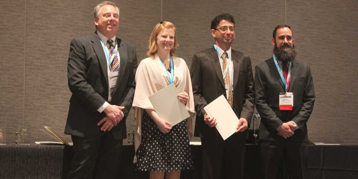 Sid Pathak receives his award with other members of The Minerals, Metals and Materials Society