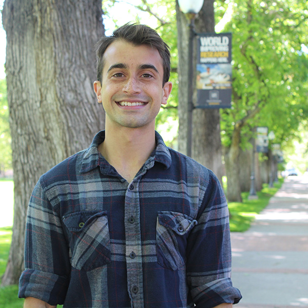 Adam Kirosingh stands in the Quad