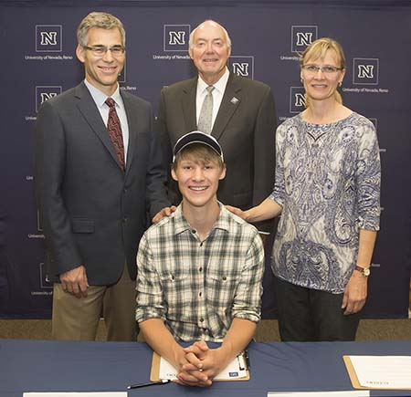 National Merit Duncan Boren of Davidson Academy with his parents and UNR President Marc Johnson