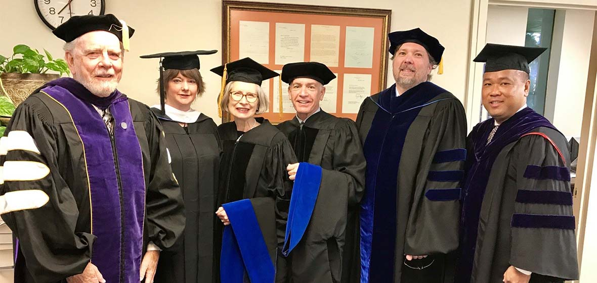 Judicial Studies Graduates in formal commencement hoods