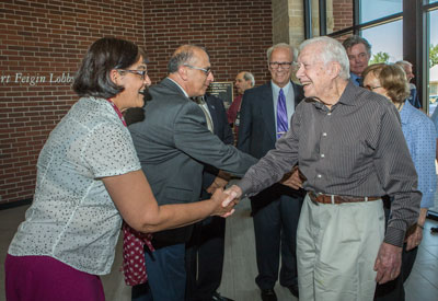 Associate Dean Indira Chatterjee greets Jimmy Carter and Department Chair Ahmad Itani greets Rosalynn Carter