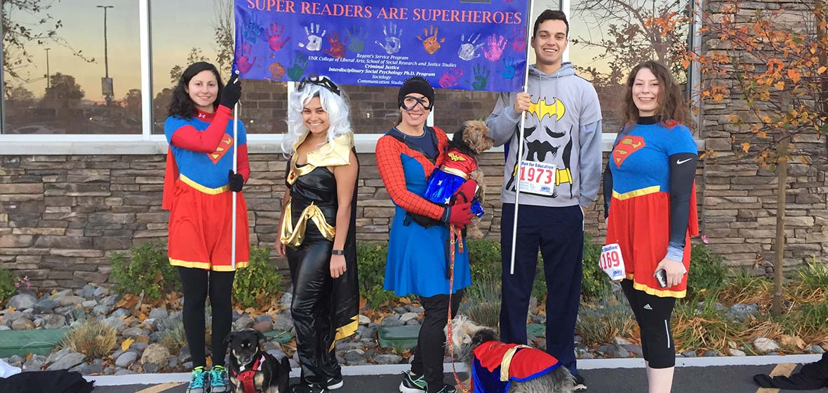 University students dressed up as superheroes to promote Washoe County literacy program