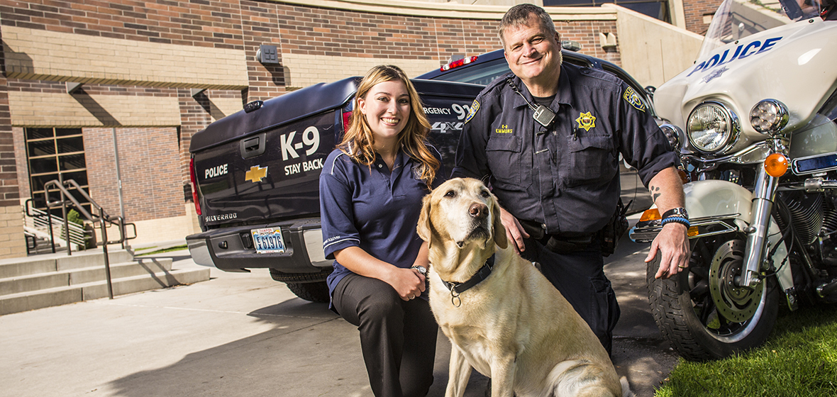 Officer Thomas Evans and his dog Turner accompanied by a female police officer (name unknown)