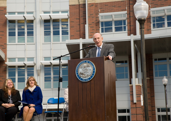 Joe Crowley speaking in front of the Joe Crowley Student Union at the dedication ceremony