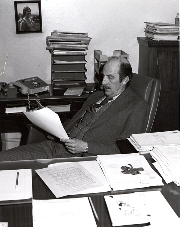 Joe Crowley working hard at his desk in the early years