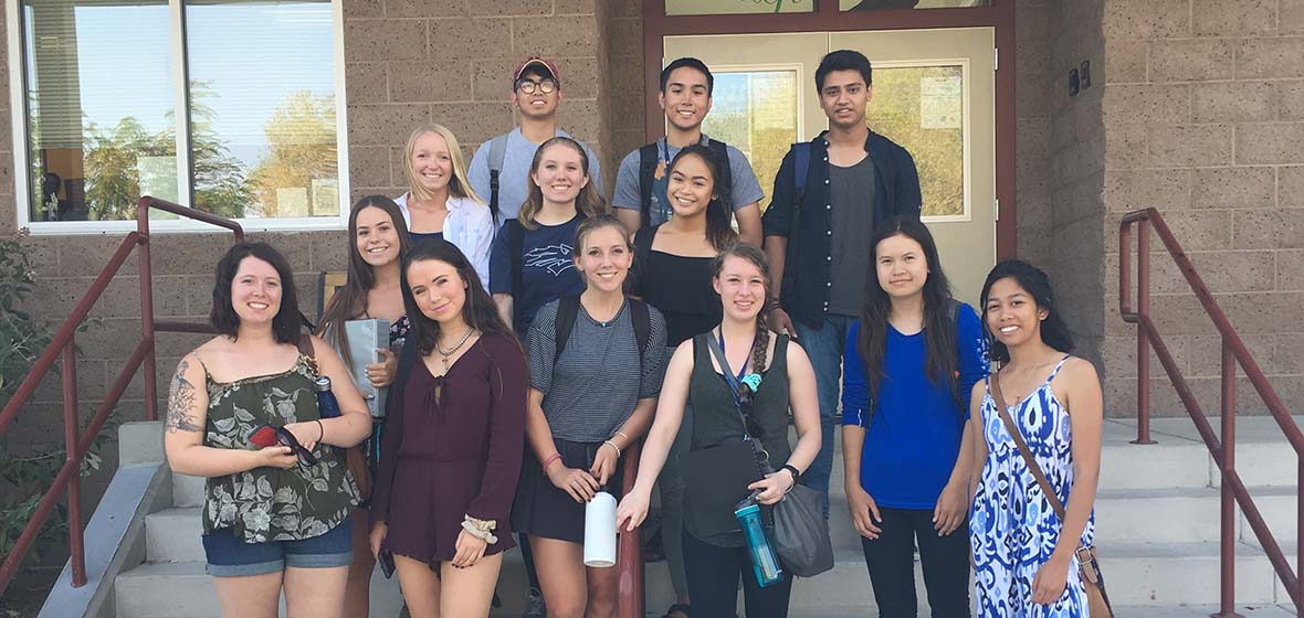 University Honors Program student group outside on steps of Reno Elementary School
