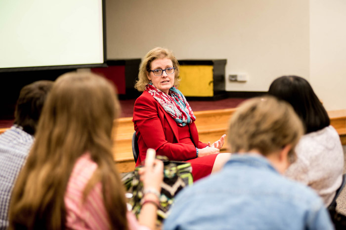 Julie Robinson speaks to students in a classroom