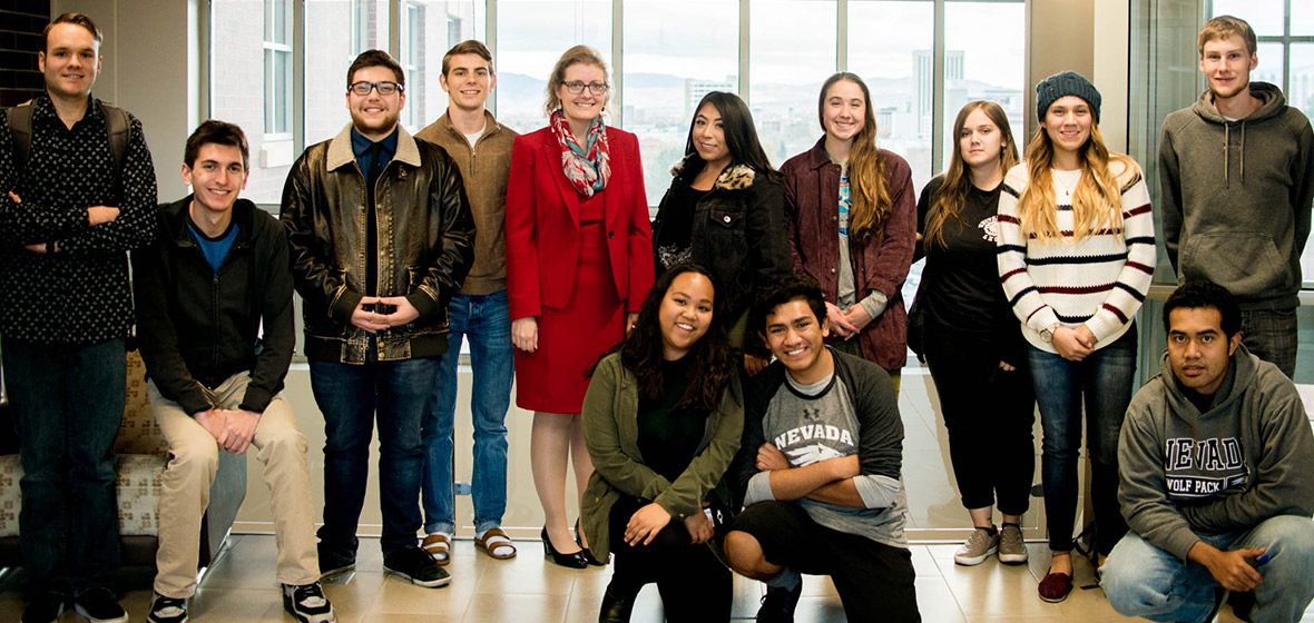 Students stand with julie Robinson for a photo