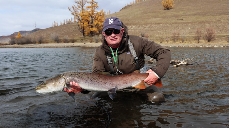 Dean Thompson with a taimen