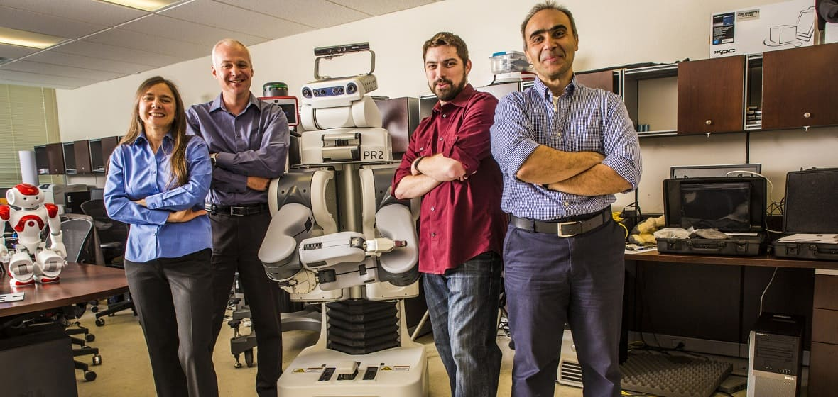 Robotics research faculty with the PR2 robot