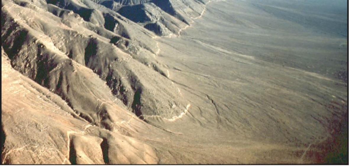A photo showing the mountain range and fault line in Pleasant Valley following the 1915 earthquake.