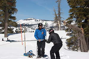 Geography professor Doug Boyle with grad student Paul Fremeau measure water content in the snow the old-fashioned way on Donner Summit