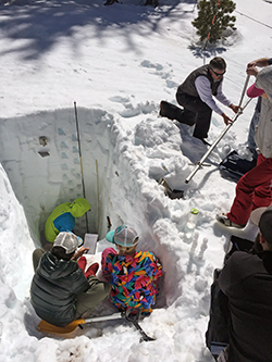 Students dig snow pit for science
