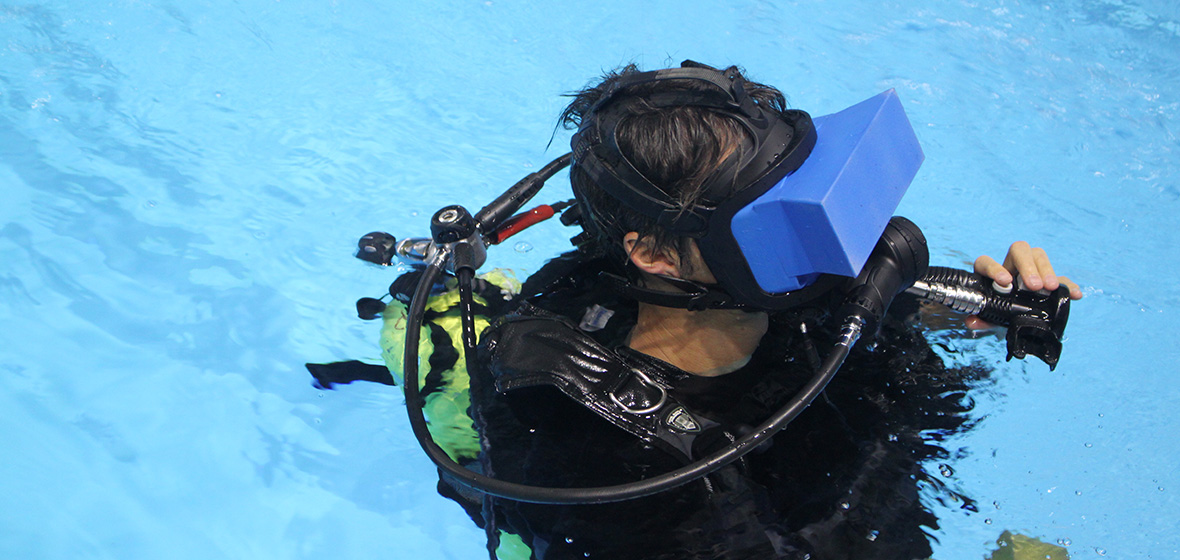 Paul MacNeilage scuba diving with VR headset