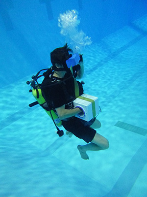 Paul MacNeilage scuba diving in pool with VR headset