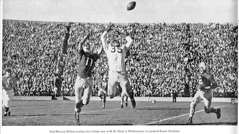 End Horace Gillom battles for a high one with St. Mary's Wedemeyer in packed Kezar Stadium