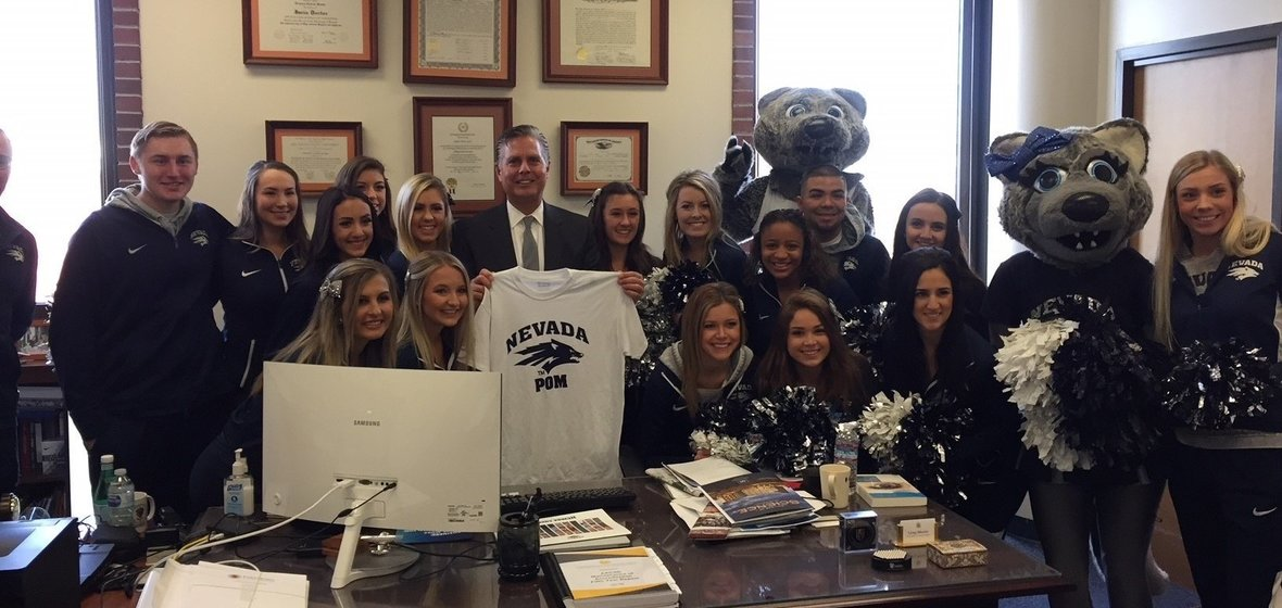Business Dean Greg Mosier with cheerleading team