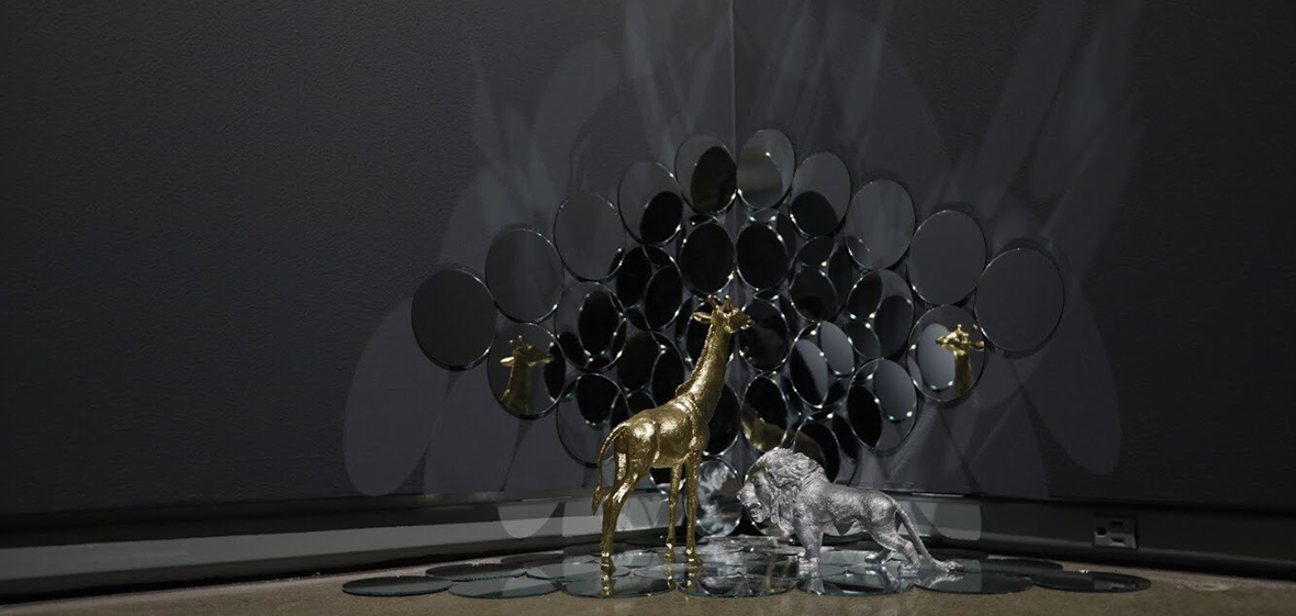 """Self existences"" by Mahedi Anjuman. A mixed sculpture piece with golden girafe and silver lion on mirrored background."