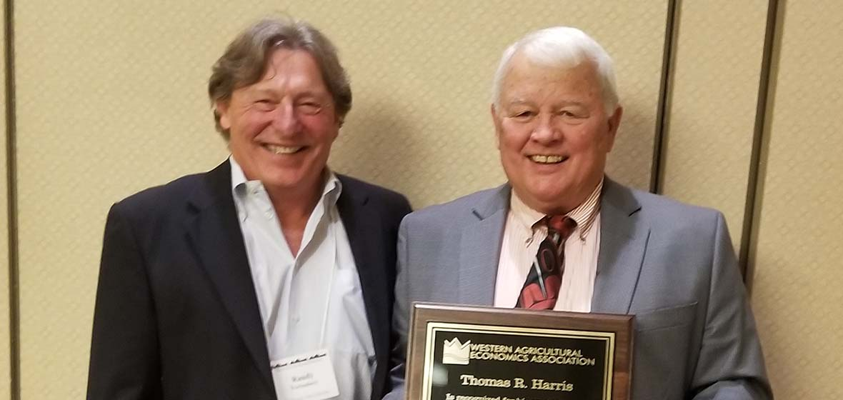 Tom Harris and WAEA President Randy Fortenbery holding Fellows award