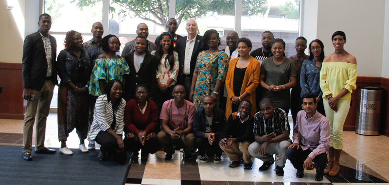 The 2018 Mandela Washington Fellows pose with University President Marc Johnson in the Mathewson-IGT Knowledge Center.
