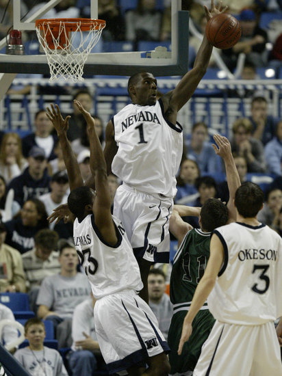 Nevada men's basketball player Kirk Snyder blocking a shot during the game against the Vermont Catamounts in 2003