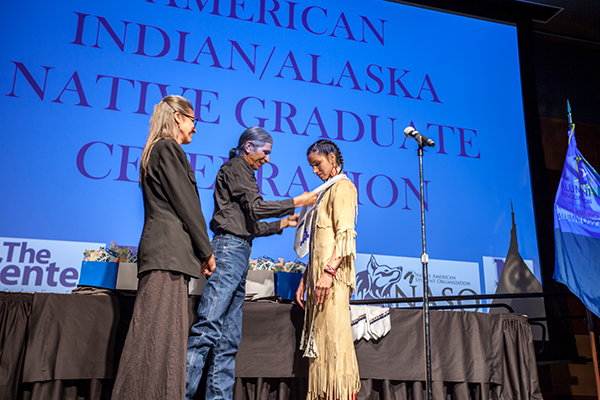 A graduate being honored at the American Indian & Alaskan Native Graduate Celebration