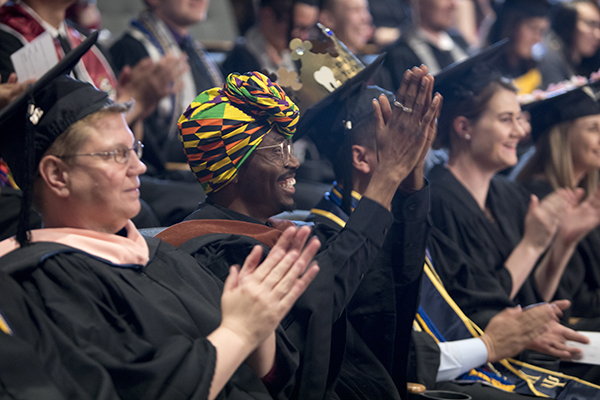 Graduates applaud at the Lavender Graduate Celebration