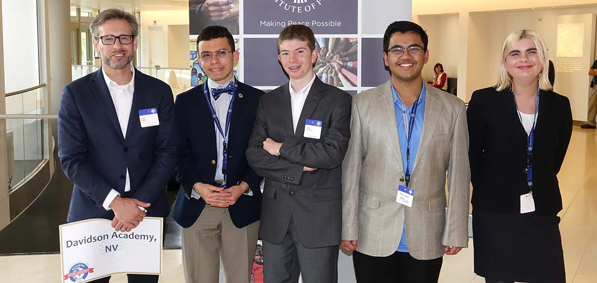An instructor and four students at the United States Institute of Peace reception for the 2018 national Academic WorldQuest competition