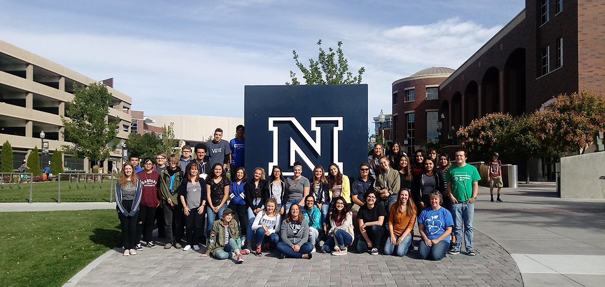 Students from Carson High School's EDUCARSON program, sit in front of the large blue N located outside the University's Mathewson-IGT Knowledge Center.