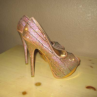 High-heeled pink and sparkly stiletto shoes worn by a sex worker at a Nevada brothel