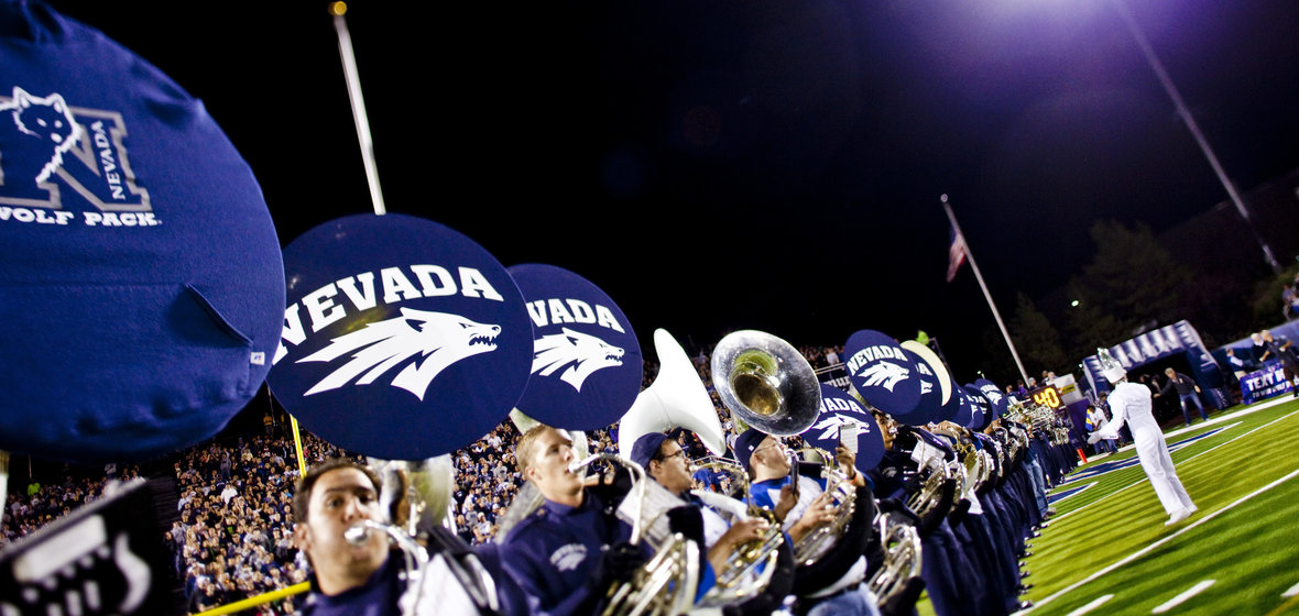 Members of the Nevada Marching Band in a line of Sousaphones.