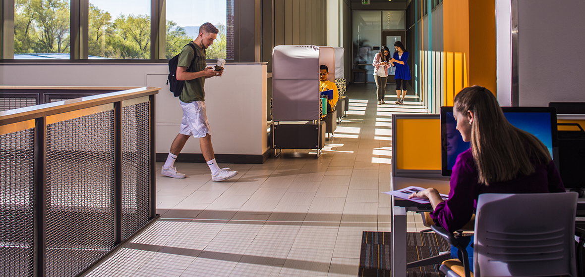 Students moving around the second floor of the Pennington Student Achievement Center.