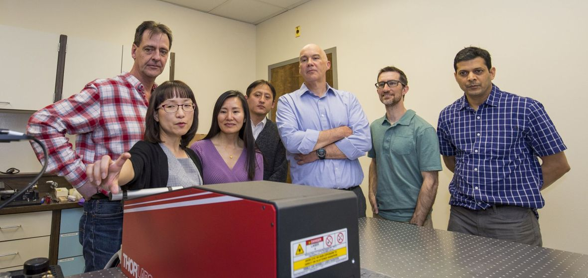 "Seven faculty members view demonstration of a large-size ""two-photon"" microscope"