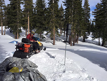 Angela Pitera conducts chickadee science from a snowmobile