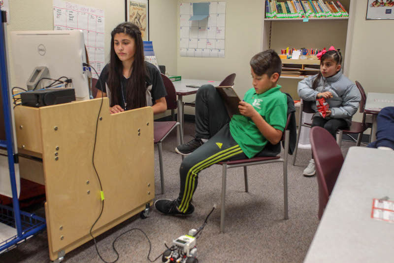 Students programming their Lego Mindstorm robots.