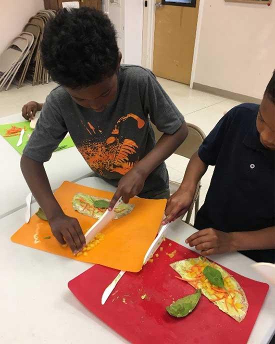 children making veggie wraps