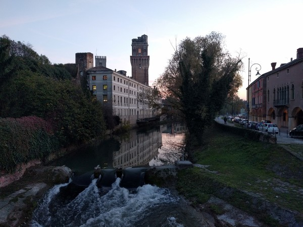 La Specola, the canal, and porticoed sidewalks in Padova