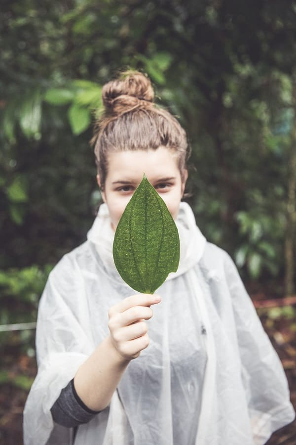 Ava Dieden holds a leaf in front of her face
