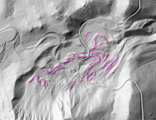 A black and white representation of the LIDAR scan of Mount Rose with pink links snaking along the sides of the mountain indicating glacial moraines
